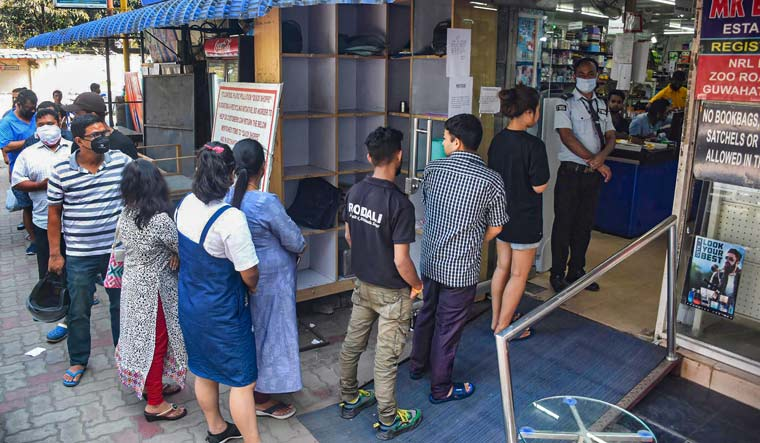 Locals stand in a queue to buy vegetables and essential commodities after government ordered lockdown amid coronavirus pandemic, in Guwahati | PTI