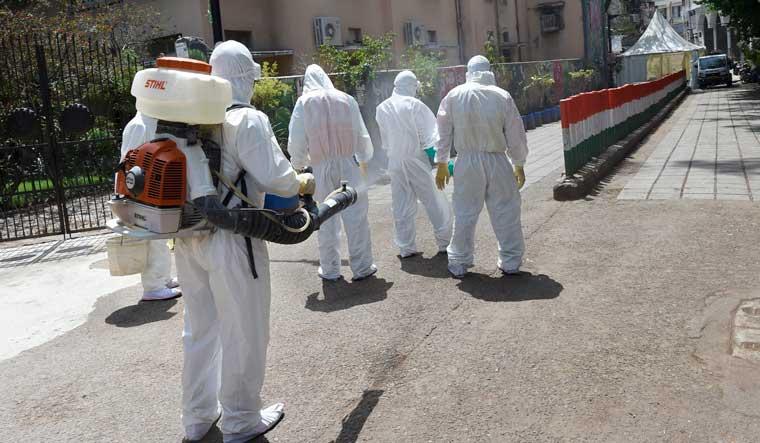 tablighi-jamath-healthcare-workers-sanitise-spray-PTI