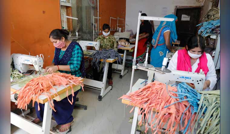 Women from a Self-Help Group (SHG) making khadi protective masks in Lucknow