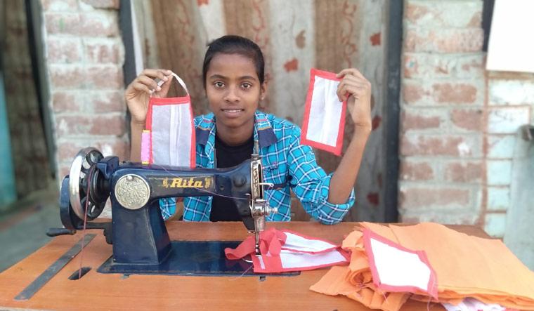 Ananya Patel sewing face masks at her home in Varanasi