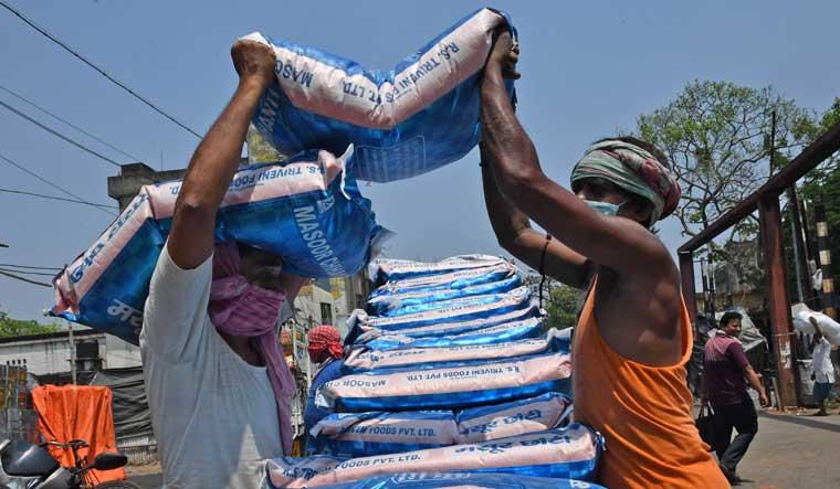 labourers-food-grains-sacks-Salil