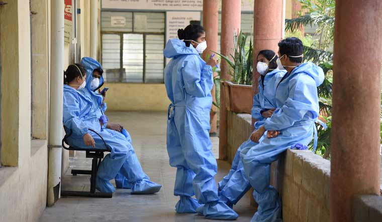 Medics wearing protective suits are seen at a hospital in Bengaluru | PTI