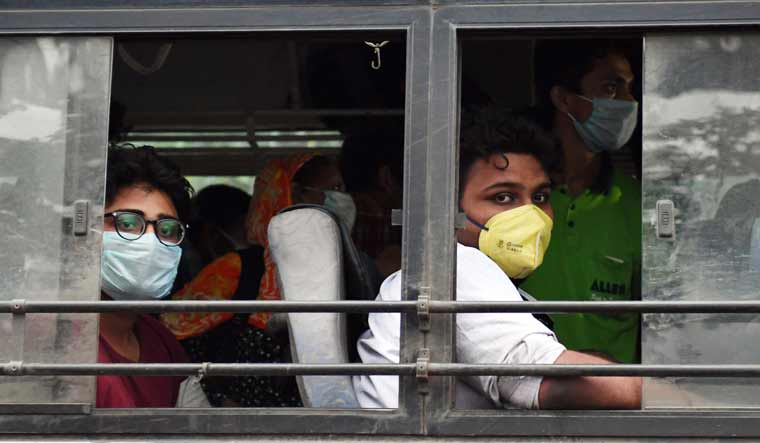 Students from Kota arrive in Kolkata on a bus during the nationwide lockdown | Salil bera