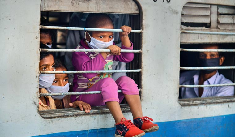 Migrants onboard a train leave for their native places in Bihar, during ongoing nationwide COVID-19 lockdown, in Dehradun | PTI