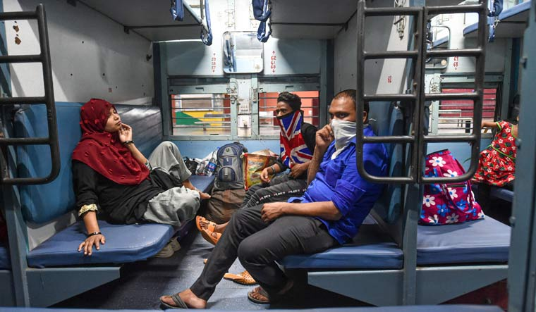 Passengers onboard a train at Charbagh railway station in Lucknow | PTI
