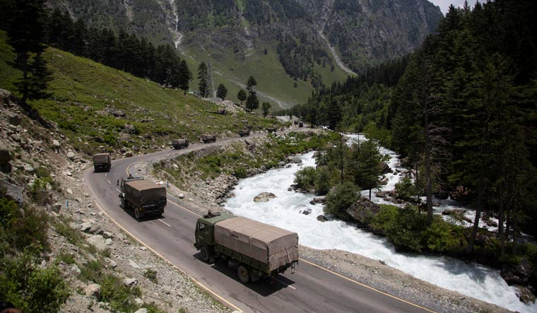 [File] An Indian Army convoy moves on the Srinagar- Ladakh highway at Gagangeer | AP