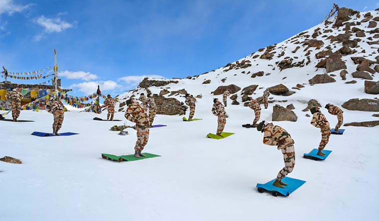 ITBP personnel practice 'yoga' on the 6th International Day of Yoga, at Khardung La in Ladakh | PTI