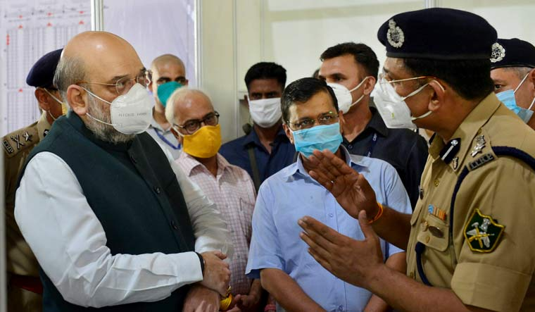 Home Minister Amit Shah, with Delhi Chief Minister Arvind Kejriwal, visits Sardar Patel COVID Care Centre and Hospital, in New Delhi | PTI