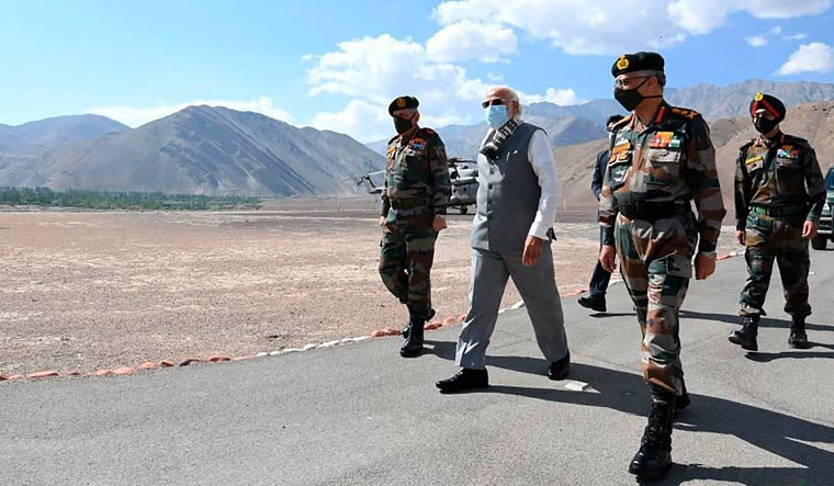 Prime Minister Narendra Modi walks with soldiers during a visit to the Ladakh area | PIB/AP