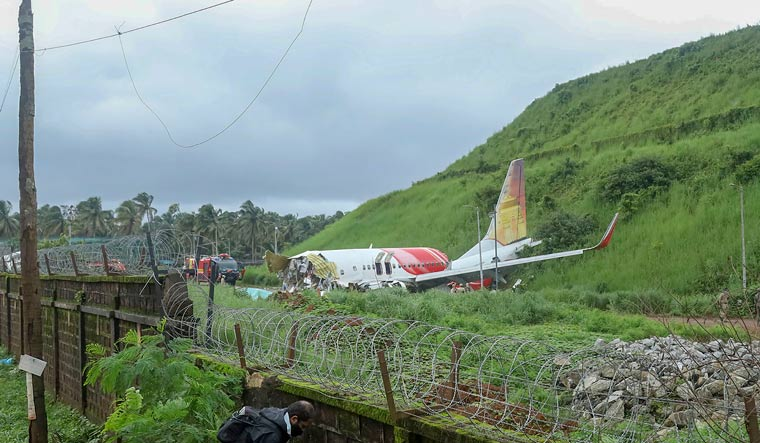 Mangled remains of an Air India Express flight after it skidded off the runway and fell into a valley while landing at Kozhikode airport | PTI