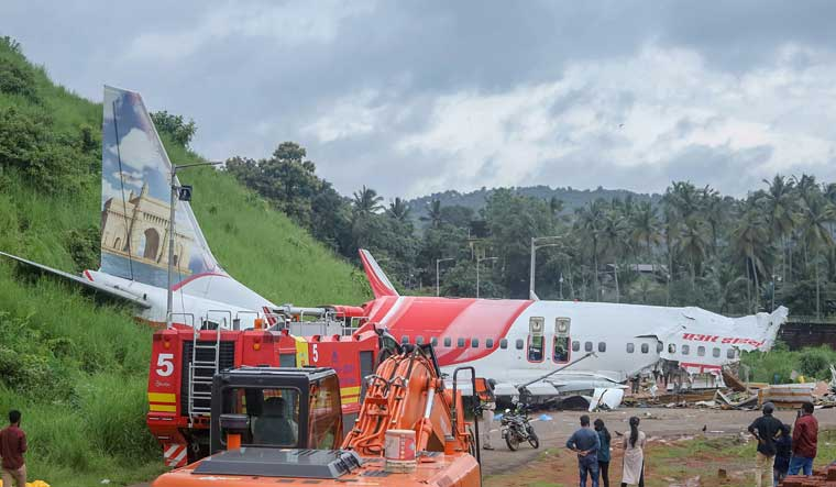 Mangled remains of an Air India Express flight after it skidded off the runway while landing at Kozhikode airport | PTI