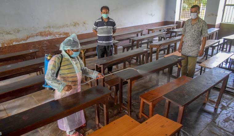 A worker disinfectants a classroom of a school in Prayagraj | PTI