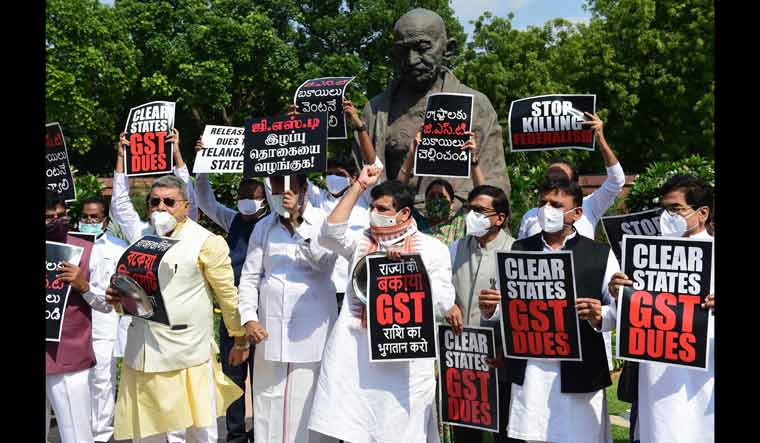 Members of various political parties stage a protest, demanding the clearance of states' GST dues, at Parliament House in New Delhi | PTI