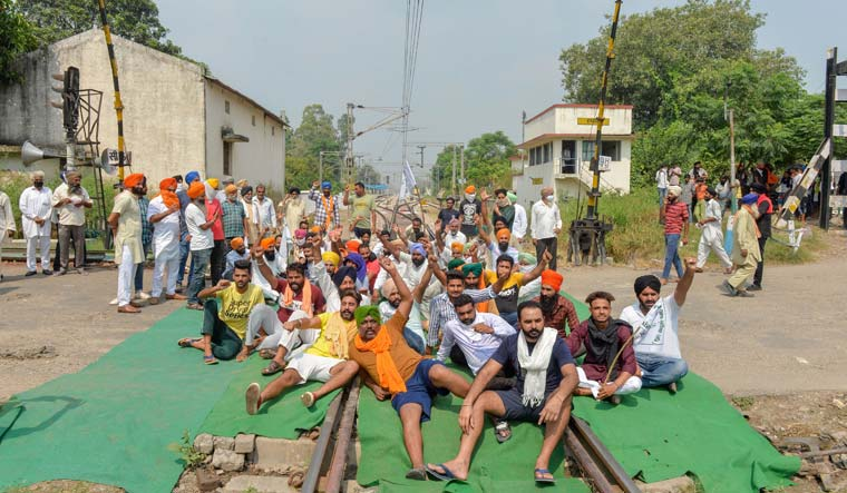 Members of various farmers' organisations block a railway track during a protest over farm bills, in Rupnagar district of Punjab | PTI