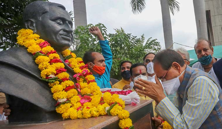Madhya Pradesh Chief Minister Shivraj Singh Chouhan pays tribute to the founder of Jana Sangh Pt. Deendayal Upadhyay on his birth anniversary, at BJP state headquarters in Bhopal, Friday | PTI