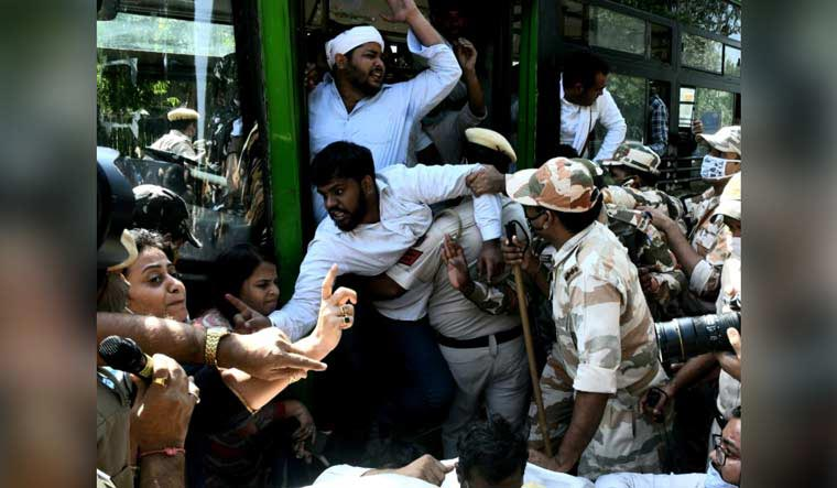 Police remove protesters from the premises of UP Bhawan in Delhi | Aayush Goel