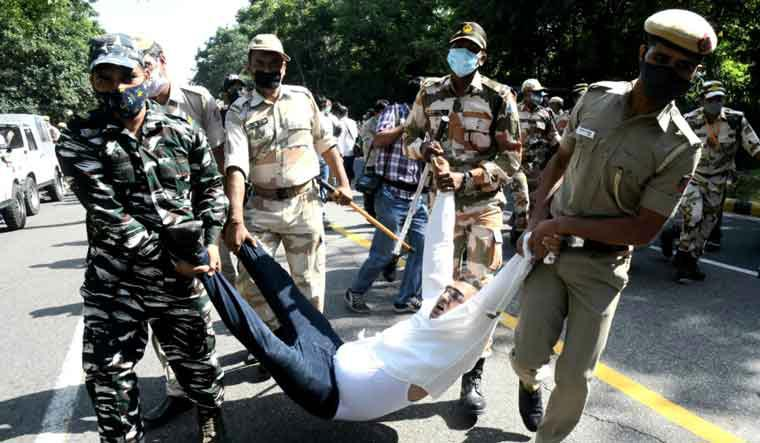 A protester is carried away by security personnel near UP Bhawan in Delhi | Aayush Goel