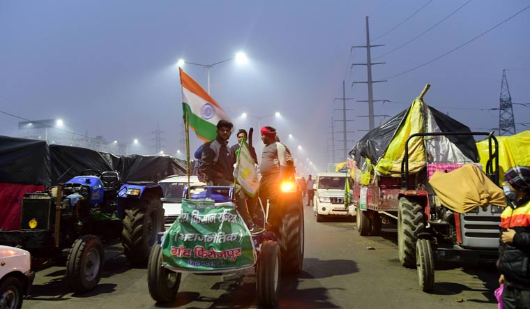 Farmers stage a protest against Centre's farm reform laws at Ghazipur border in New Delhi | PTI