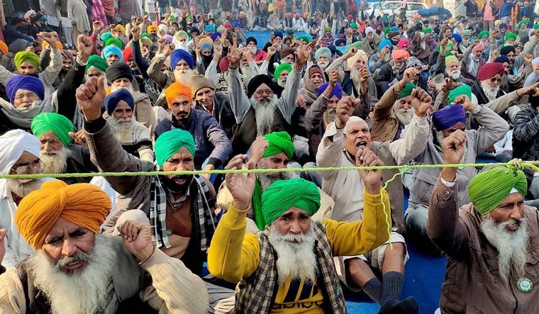 Farmers stage a protest against Centre's farm reform laws at Tikri border, in New Delhi | PTI