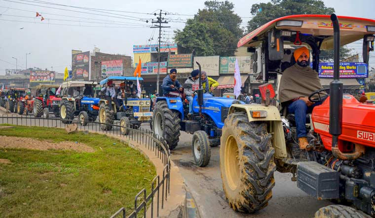 Farmers take out a tractor march in Amritsar as part of the preparations for their planned tractor parade in the national capital on Republic day | PTI