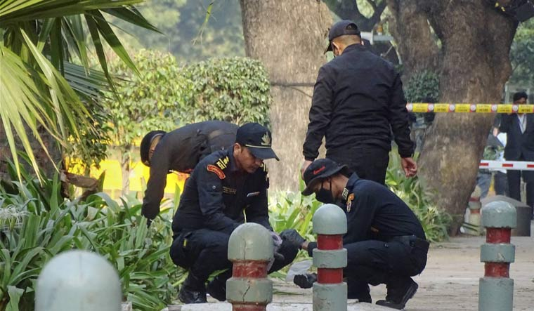 An NSG team inspects the blast Site near Israeli Embassy in New Delhi | PTI