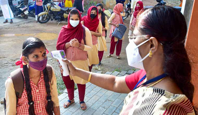 [File] Students undergoing temperature scanning at a school in Palakkad, Kerala   PTI