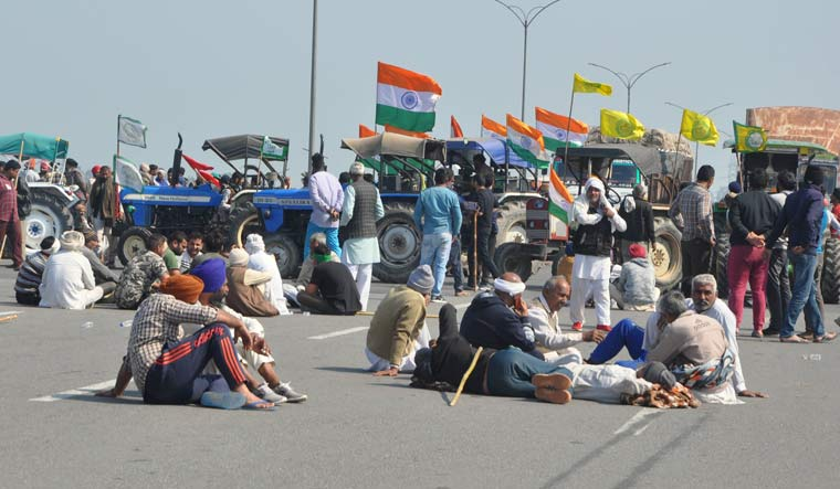 Farmers block a road at Singhu border during their 'chakka jam' protest on February 6 |  PTI