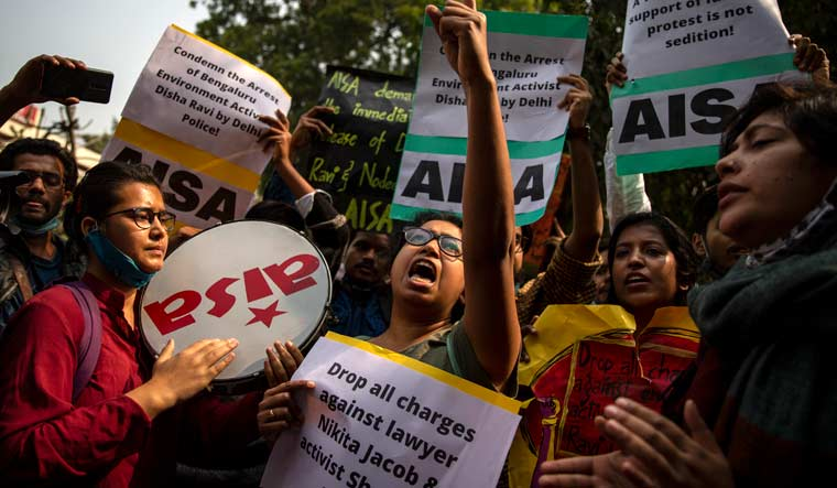 Students hold placards and shout slogans condemning police action against various activists during a protest in New Delhi   AP
