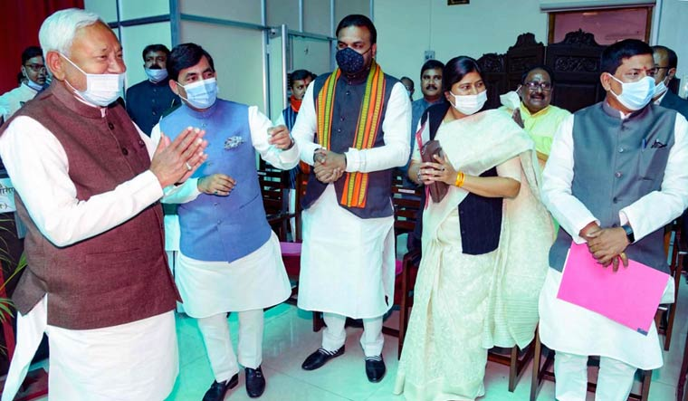 Bihar Chief Minister Nitish Kumar meets with new ministers of NDA government after oath ceromany function at Raj Bhawan | PTI