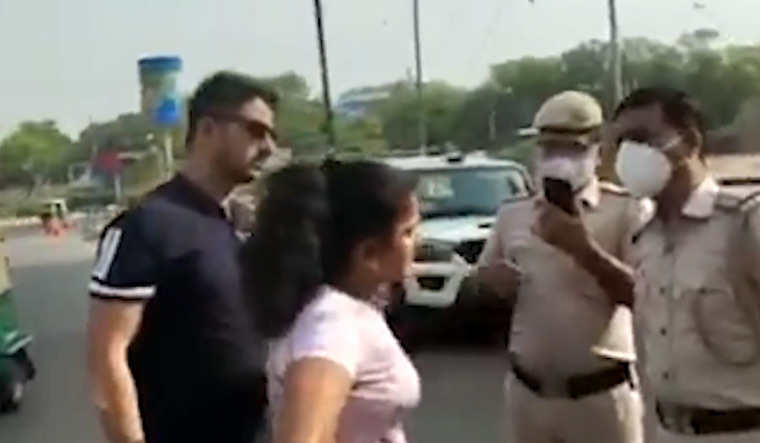 In a video shared on social media, the couple could be seen misbehaving with Delhi police personnel when they were asked the reason for not wearing masks   Screengrab