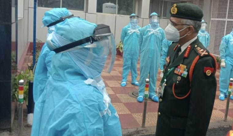 [File] Indian Army chief General M.M. Naravane interacting with COVID-19 warriors at the Base Hospital Delhi Cantonment   Twitter handle of ADGPI