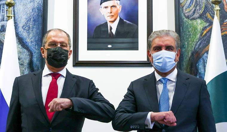Russian Foreign Minister Sergey Lavrov, left, and Pakistani Foreign Minister Shah Mahmood Qureshi pose for a photo prior to their talks in Islamabad | AP