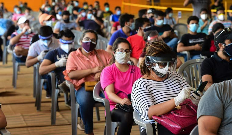 People over 18 years of age wait to receive COVID-19 vaccine doses at one of the largest vaccination sites set up by BLK-Max hospital at Radha Soami Satsang Beas grounds, in New Delhi | PTI