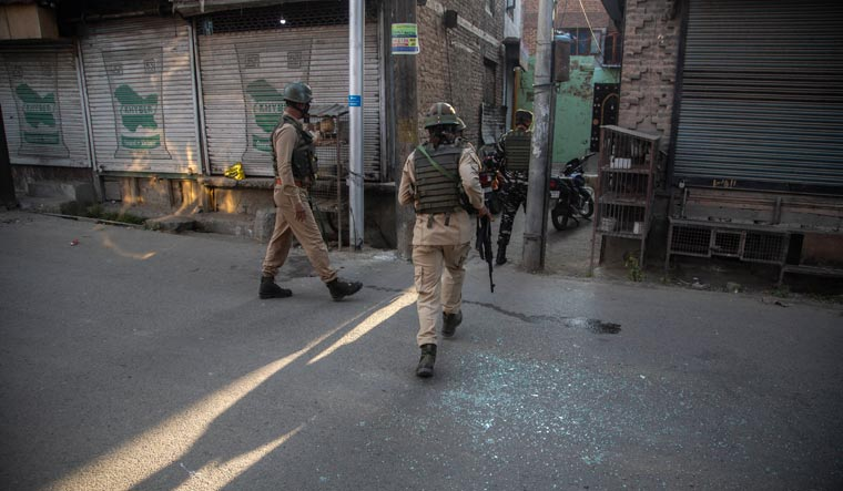 Soldiers keep guard at the site of a grenade attack on a security force post in Srinagar, in Jammu and Kashmir | AP