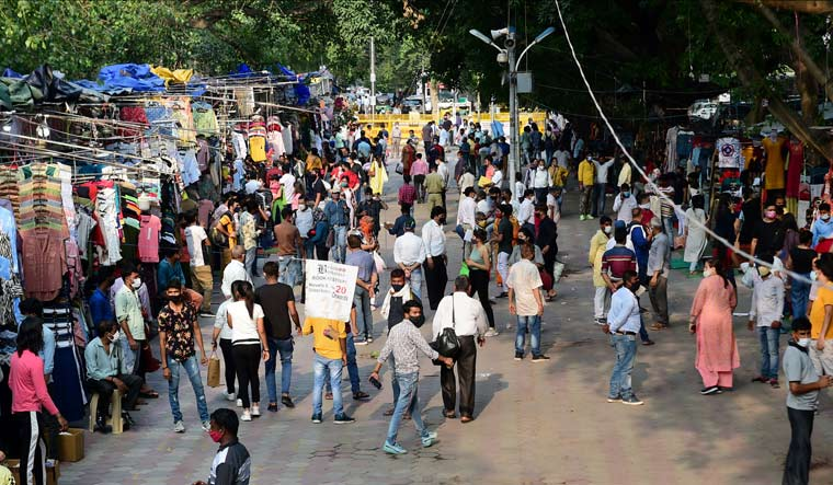 People crowd at Janpath market during COVID-19 lockdown relaxation, in New Delhi | PTI