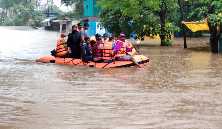 NDRF personnel rescue people stranded in floodwaters in Kolhapur | AP