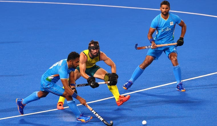 Harmanpreet Singh of India in action with Jeremy Hayward of Australia | Reuters