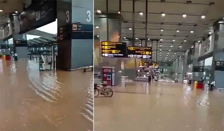 delhi-airport-flooded-pics-pti