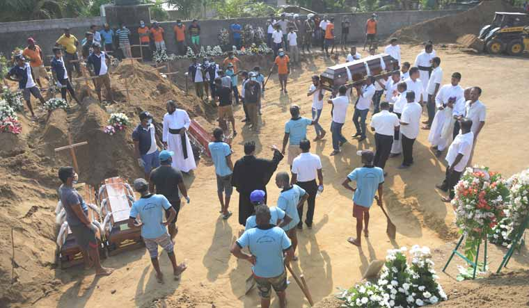 Negombo funeral Lanka blasts Bhanu