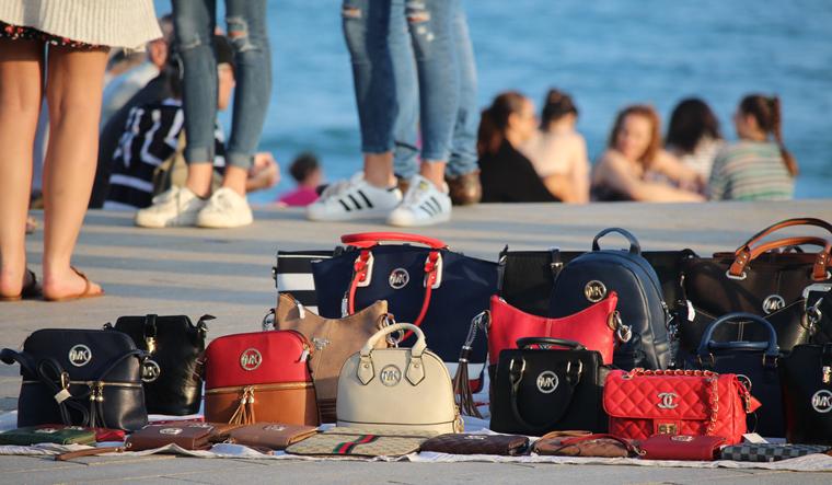 copies-popular-brands-women-barceloneta-beach-shut
