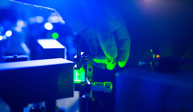 laser-quantum-optics-researcher-adjusting-laser-beam-lab-shut