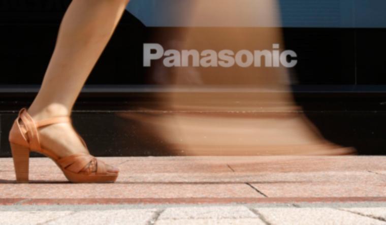 woman-walks-past-a-logo-of-panasonic-reu