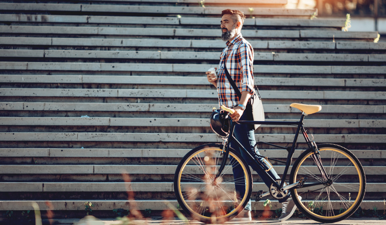 cycling-to-work-young-man-business-