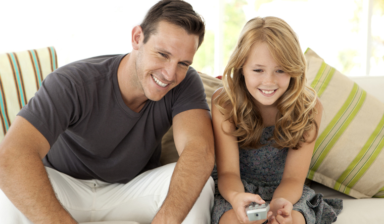father-daughter-family-tv-remote-television