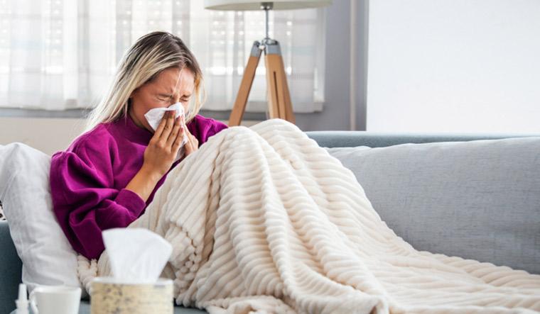 woman-common-cold-flu-sneeze