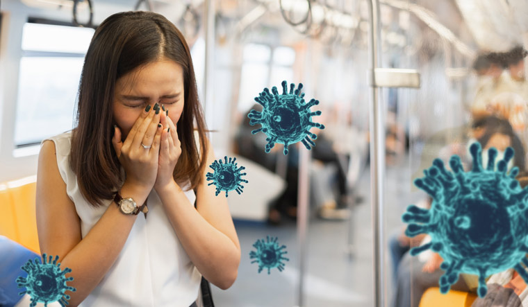 Coronavirus-covid-19-woman-sneezing-cough-without-protective-face-mask-in-metro-train-shut