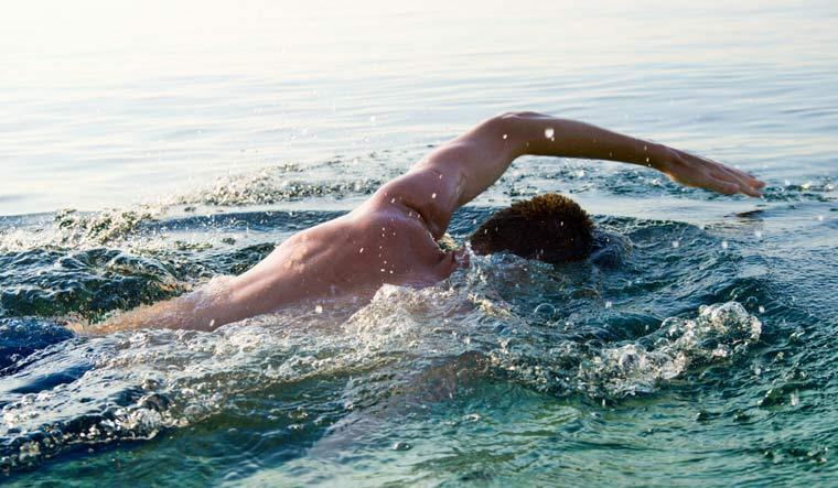 man-swimming-in-sea-water-ocean-shut