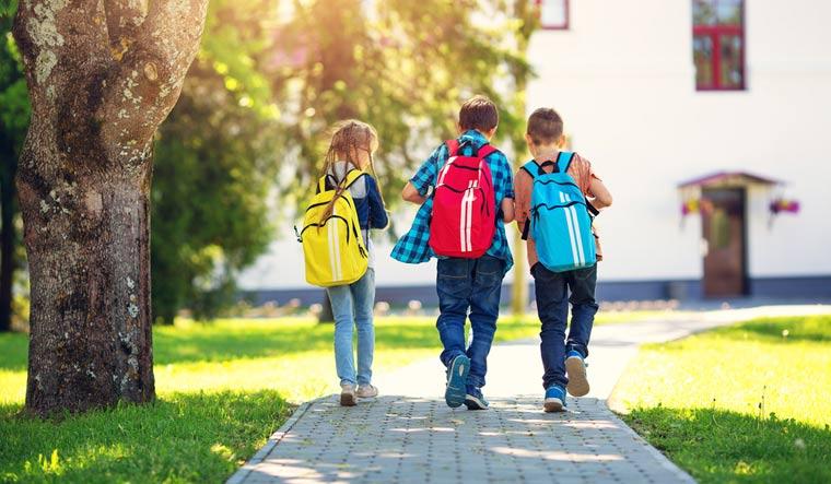 school-elementary-school-children-school-bag-backpacks-walking-shut