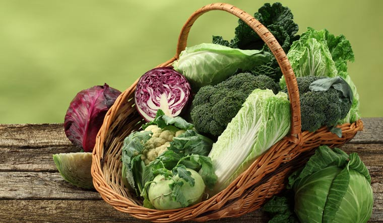 Different-types-of-cabbage-in-a-basket-vegetables-shut