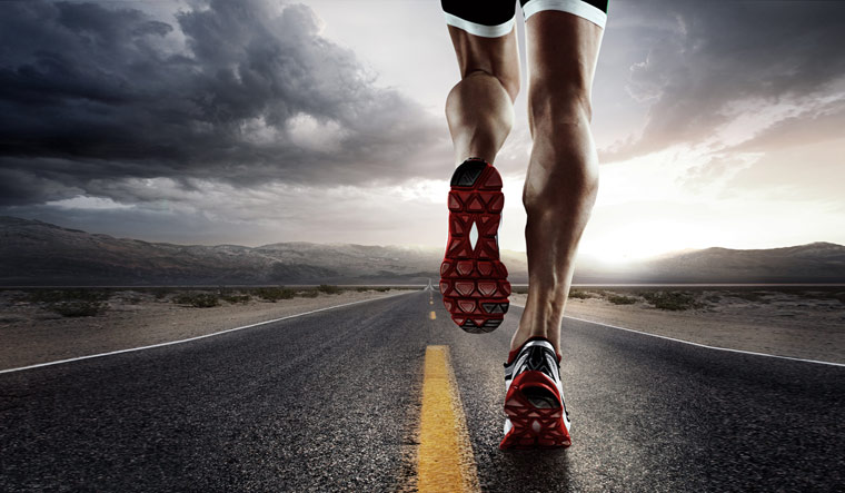 Sports-Runner-feet-running-on-road-closeup-on-shoe-endurance-running-shut